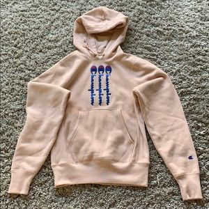 A women's extra-small pink champion hoodie
